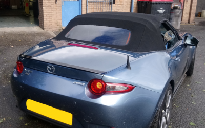 Mazda MX 5 with rear screen tinted.